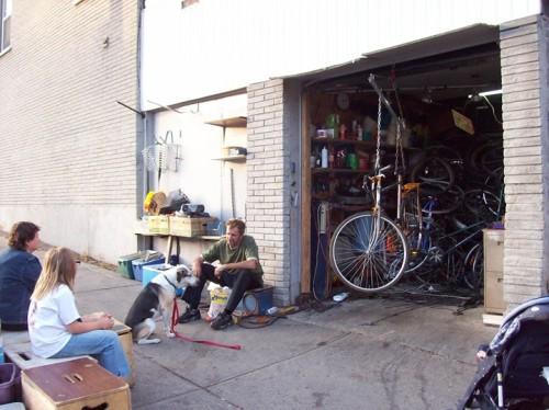 Renaud, his bike shop + Elliot